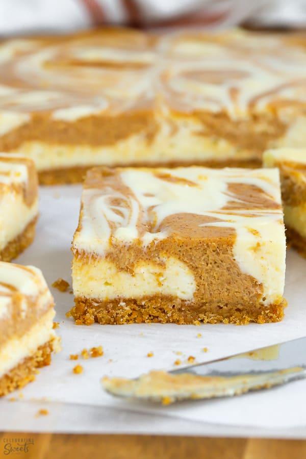 These swirling pumpkin cheesecake bars feature graham cracker crust, pumpkin pie and creamy cheesecake flavors.