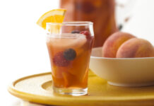 This Peachy Iced Tea Sangria has a fruity twist on iced tea that's packed with delicious summer berries and peaches.